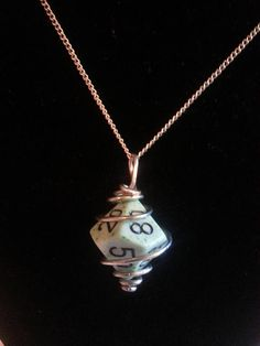 Wire wrapped dungeons and dragons gamer dice pendant necklace available in my Etsy shop https://www.etsy.com/listing/532443001/wire-wrapped-10-sided-dice-pendant