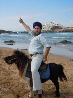 This prince and his majestic steed. | The 49 Most WTF Pictures Of People Posing With Animals