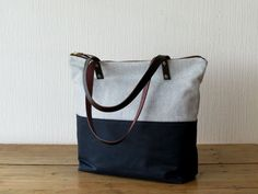 Two Tone Waxed Canvas and Wool Tote Bag with leather handles. This roomy and functional bag can be the perfect companion for your daily adventures.