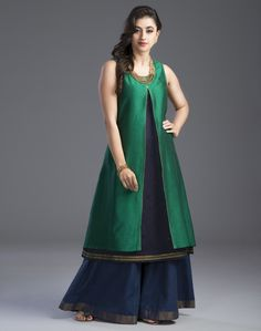 Dress up for the special occasions in this silk cotton 2 piece kurta set. The tissue trim lends it a festive look. Silk Cotton Scoop Neck Sleeveless With Slip Dry Clean Only