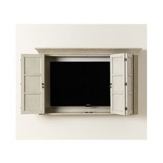 The Shutter TV Wall Cabinet is the best solution wee found to conceal a wall-mounted TV when you're not watching. Armoires Murales Tv, Tv Escondida, Entryway Storage Cabinet, Tv Cabinet For Bedroom, Bedroom Tv Wall, Storage Shelves, Tv Plasma, Armoire Tv, Tv Wall Cabinets