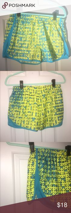 Women's Under Armour athletic shorts, size medium Green/blue women's Under Armour semi-fitted heat gear running shorts WITH built in underwear lining. Under Armour Shorts