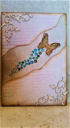Butterflies of stardust!!! Scrapbooking on small canvas with chipboards, distress inks and flatback rhinestones. Brown and turquoise make the perfect combination!