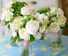 bouquets using green hydrangea, parrot tulips,  and soft white peonies and garden roses