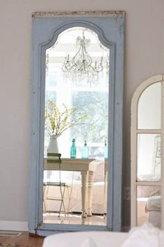 Turn an old door frame into an elegant standing mirror