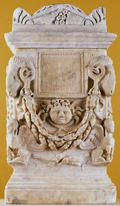Cinerary Box with Cover  ARTIST:Roman  DATE:1st century  his cinerary urn resembles a small building with pitched roof. The inscription attests that it contained the ashes of a man and a woman, possibly husband and wife, who were freed slaves.