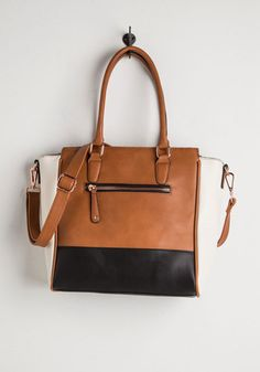 Triple the Charm Bag in Cognac. Effortlessly increase your ensembles allure by toting this structured, colorblocksatchel! #tan #modcloth