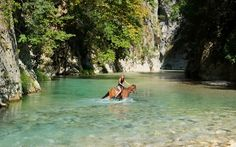 Horse riding in the River Acheron - the mythical River Styx in Greece