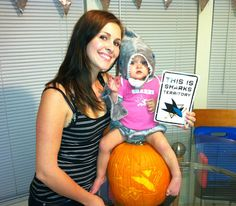 Kimberly and her daughter pose with their very first carved #Sharkoween pumpkin.