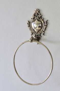 Always in high demand. A sturdy towel ring with a classic French-scroll design on the back plate. Suitable for big towels and bath sheets. back plate – x - Silver plated on brass - Made in India - Imported by Masquerade Towel Rings, Bath Sheets, Back Plate, Scroll Design, Masquerade, Silver Plate, Plating, Brass, Brooch