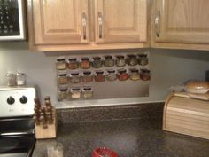 I got tired of my plain, old, dumpy lazy susan spice rack taking up space on my kitchen counter, so I decided to make a wall mounted magnetic spice rack. for more pictures and DIY fun, go here: angelpeach838.wordpress.com