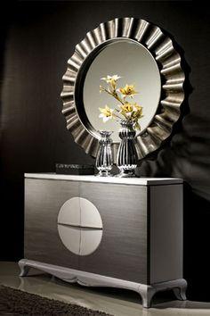 moderno mueble recibidor con espejo tambin circular que un aire sofisticado a la entrada de