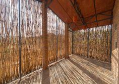 Sharon Davis' housing for Rwandan healthcare workers is wrapped in eucalyptus screens.