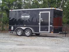 black on black ATP enclosed trailer with harley davidson stickers 7 x 14