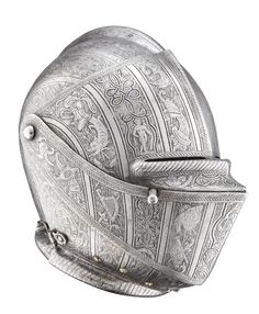 """ttamarshall: """"A FINELY ETCHED NORTH ITALIAN CLOSE HELMET FOR THE FOOT TOURNEY, MILANESE, CIRCA 1590 with rounded one-piece skull rising to a low medial comb, and visor, prow-shaped upper bevor and bevor (the first two restored) attached to it by dome-headed common pivots (replaced), the visor formed with a stepped and centrally-divided vision-slit and fitted at its right side with a projecting lifting-peg, the bevor pierced at the right of the chin with a large hole to receive a…"""