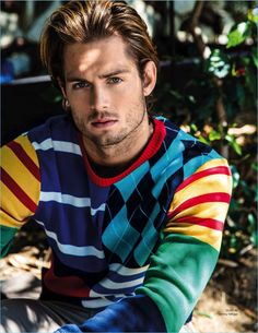 Chad James Buchanan wears a colorful Tommy Hilfiger sweater for Da Man.
