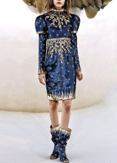 The material! The color! The pattern! The blue with gold! Yes it looks like a junior high homecoming dance dress. But... the matching boots! Chanel dress. Autumn/Winter 2010.