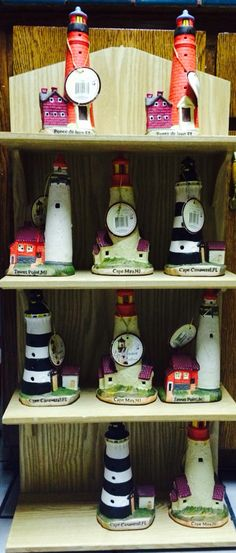 Porcelain light houses from the lighthouse collection and the wooden lighthouse case