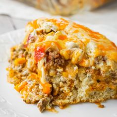 John Wayne Casserole is an easy ground beef casserole recipe with a biscuit base and loaded with diced tomatoes, corn, taco seasoning, cream cheese, mozzarella and cheddar. Easy Chicken Enchilada Casserole, Beef Casserole Recipes, Meat Recipes, Mexican Food Recipes, Cooking Recipes, Goulash Recipes, Hamburger Recipes, Mcdonalds Recipes