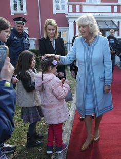 Camilla Parker Bowles Photos - . Camilla, Duchess of Cornwall, greets locals after she visited the University of Montenegro Music Academy on March 18, 2016 in Cetinje, Montenegro. The Prince and Duchess are visiting Croatia, Serbia, Montenegro and Kosovo. - The Prince of Wales and The Duchess of Cornwall Visit Montenegro