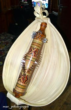 Sasando, a traditional string instrument native to Rote Island of Indonesia. The main part of the sasando is a bamboo tube, with 28 or 56 strings running the length of the instrument all around the segment of bamboo, held at various resonating lengths for the chosen tuning by wooden bridges for each string. the instrument is surrounded by a fan of dried palmyra leaves, which functions as a resonator.
