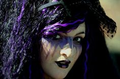 Shannon McHugh dressed as a Gothic character poses for pictures while attending the Goth festival in Whitby, North Yorkshire