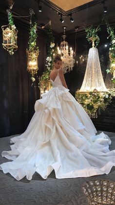 $10,500 hand beaded lace with a princess style over skirt in silk organza