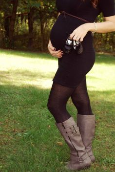 Maternity photo using baby shoes. Fall / outdoor photo