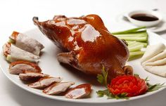 The Chinese People have perfected the art of slow roasting duck, and turned it into a staple of Chinese cuisine. Fine Chinese Dining Peking Duck, or Beijing Roast Duck is a famous item of Chinese cuisine. This duck dish has been prepared since. Goose Recipes, Duck Recipes, Asian Recipes, Chinese Recipes, Chinese Chicken Wings, Almond Chicken, Peking Duck, Roast Duck, Duck Sauce