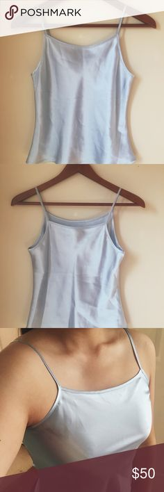 "Vintage silky cropped slip top ⋈ Blue silky smooth cropped slip top - total length: 18"" ⋈ 100% polyester ⋈ Slips are a huge spring and summer trend! ⋈ Would recommend for smaller bra sizes ⋈ Price is negotiable! Vintage Tops Tank Tops"