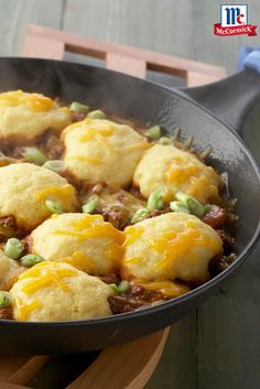 Your whole family will be digging into this one pan, hearty mixture of taco seasoned meat and beans. The topping of corn bread and Cheddar cheese makes this easy skillet dinner especially delicious.