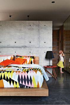 Pannekoecke-home-master-bedroom-bright-print-concrete