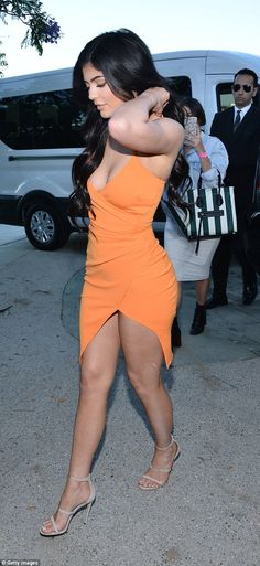 Work it: Kylie strutted into the event in her sexy little dress and a pair of strappy grey suede heels