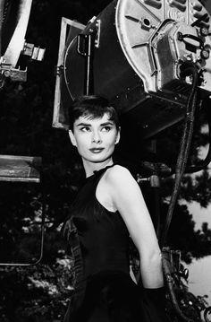 """Audrey Hepburn in the set of """"Sabrina"""" dir. Billy Wilder (1954)."""