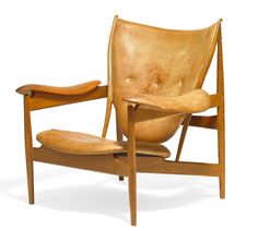 """""""Chieftain Chair"""". A teak easy chair. Seat, armrests and back upholstered with original, patinated natural leather. Back fitted with buttons. Designed 1949. This example made circa. 1950-1955 by cabinetmaker Niels Vodder, stamped."""