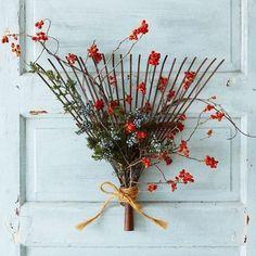Flower arrangement made from old wood or rustic leaf rake.