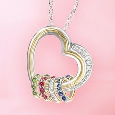 "Diamond heart necklace with up to 8 kids birthstones - love the heart-shaped birthstones! Back is engraved, ""A mother holds her children's hands for a short while, but their hearts forever."" $129"