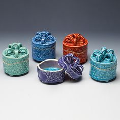 """These present-shaped boxes are stoneware and come in a variety of vibrant colors. There are two fun surprises inside. The first is a""""'Hello Gorgeous"""" message stamped in the lid. The second surprise is"""