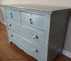 Great painted dresser with antique teardrop knobs!