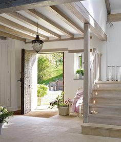 Love the big tiled floor and exposed beams