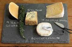 Gorgeous slate cheeseboard....perfect to write the names of each cheese with chalk.