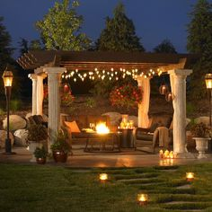 A very nice outdoor patio setup with a huge pergola by Outdoor Greatroom Company