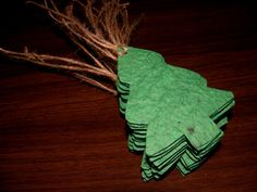 Christmas Gift Tags Made of Green Plantable Paper in Christmas Tree Shapes Embedded With Wildflower Seeds, by Davita, $15.75 for 35 tags, www.davita.etsy.com
