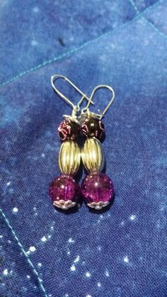 Check out this item in my Etsy shop https://www.etsy.com/listing/225605783/purple-and-silver-beaded-earrings