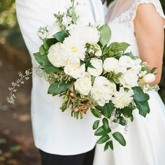 Beautiful simple bouquet with white flowers and greenery.