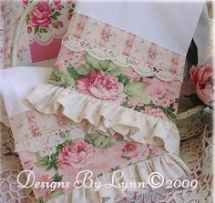 White tea towels with pink florals trimmed with oatmeal colored & white polka dots and a touch of lace...