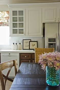 two tone cabinets http://designstiles.me/2013/05/28/kitchen-makeover/