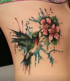 Watercolor tattoos are amazing. I ned one , I want a water color owl
