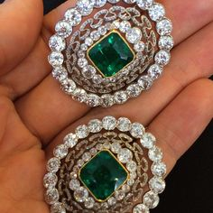 A pair of very delicate Belle Epoque #emerald and #diamond brooches. Available in our #Geneva Magnificent Jewels sale on May 13. #ChristiesJewels