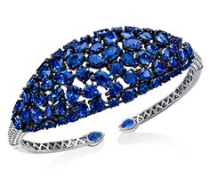 Cellini Jewelers Gorgeous Sapphire and Diamond Cuff. 25.23 carats of rose cut sapphires, and 1.09 carats of round brilliants make up this exceptional cuff. Set in 18 karat white gold, and 18 karat blackened gold adding that extra edge.